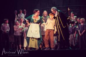 Frankie Alexandra (Widow Corney), Mason Chandler-Wickens (Oliver), Guy Grimsley (Mr Bumble) and ensemble